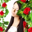 Beautiful girl with bright make-up among the roses — Stok fotoğraf