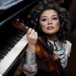 Woman with a violin — Stock Photo #11293227