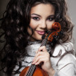 Stock Photo: Woman with a violin