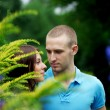 Lovers in the park on a date — Stockfoto