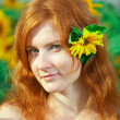 Red-haired woman with sunflowers — Stock Photo