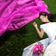 Beauty bride with a long purple veil — Foto de Stock