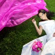 Beauty bride with a long purple veil — Stock Photo