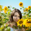 Woman with blue eyes with sunflowers — Foto Stock