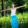 Beautiful girl in a summer forest — Stock Photo