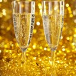 Champagne against the gleaming bokeh - Stock Photo
