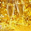 Champagne against the gleaming bokeh — Stock Photo