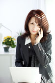 Business woman talks on the phone — Stock Photo