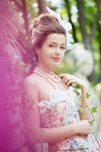 Princess in an vintage dress in nature — Stock Photo