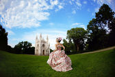 Princess in an vintage dress before the magic castle — Stock Photo