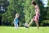 Mother and son playing ball in the park. — Stok fotoğraf