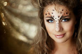 Girl with an unusual make-up as a leopard — Stok fotoğraf
