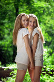 Women, twins in the forest — Stok fotoğraf