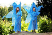 Two woman, twins in the forest — Stock Photo