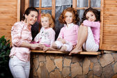 Three little girls, cute kids with mother — Stock Photo