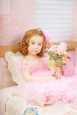 Girl in the nursery in pink dresses — Stock Photo