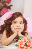 Girl in the nursery in pink dress — Stock Photo
