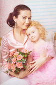 Ñute little girl, a child in a dress with mother — Stock Photo