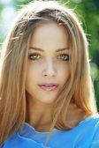 Beautiful girl with blue eyes — Stock Photo