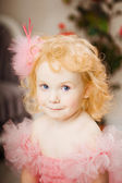Child in a pink dress on a toy horse — Stock Photo
