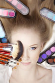 Stylist makeup artist with brushes and cosmetics — Stock Photo