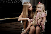 Cute little girl, a child with mother — Stock Photo