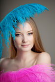 Beautiful girl with colorful feathers — Stock Photo