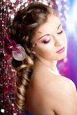 Woman with a wonderful luxury makeup and hairstyle — Stock Photo