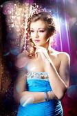 Beautiful girl in a nightclub — Stock Photo