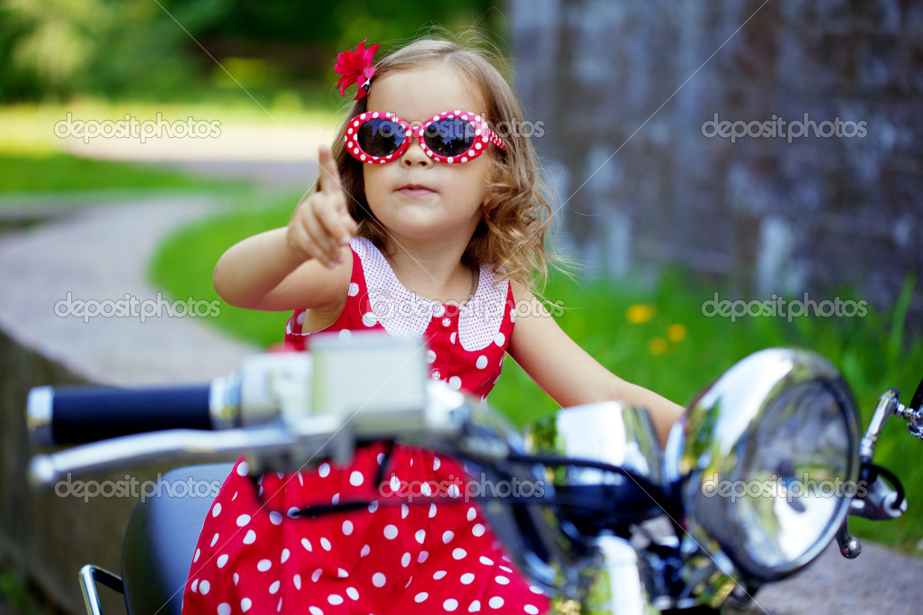 http://static9.depositphotos.com/1265894/1129/i/950/depositphotos_11291971-Girl-in-a-red-dress-on-a-motorcycle.jpg
