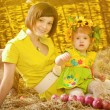 Girl with mother in the village — Stock Photo
