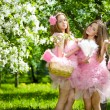 Twins in pink doll style — Stock Photo #11935625
