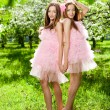 Twins in pink doll style — Stock Photo #11936085