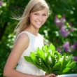 Stock Photo: Portrait of young beautiful smiling woman outdoors