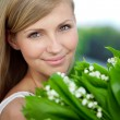 Stock Photo: Portrait of young beautiful smiling womoutdoors