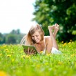 Beautiful smiling woman with tablet pc, outdoors — Stock Photo #11937770