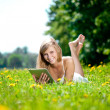 Beautiful smiling woman with tablet pc, outdoors — Stock Photo #11937793