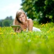 Beautiful smiling woman with tablet pc, outdoors — Stock Photo #11937820