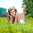 Smiling woman Woman listening to music on headphones outdoors — Stock Photo #11938083