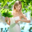 Young artistic woman with flowers outdoors — Stock Photo #11938758