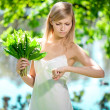 Young artistic woman  with flowers outdoors - Stock Photo
