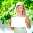 Happy beautiful smiling woman with blank poster  outdoors — Stockfoto