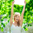 Happy beautiful smiling woman with blank poster  outdoors — ストック写真
