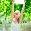 Happy beautiful smiling woman with blank poster outdoors — Stock Photo #11938961