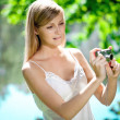 Beautiful smiling woman with a camera, outdoors — Stock Photo #11939002