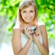 Beautiful smiling woman with a camera, outdoors — Stock Photo #11939046