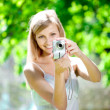 Beautiful smiling woman with a camera, outdoors — Stock Photo #11939063