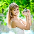Beautiful smiling woman with a camera, outdoors — Stockfoto #11939122
