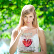 Sad woman with a heart in a cage — Stockfoto
