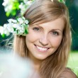 Smiling beautiful woman with flowers — Stock Photo #11939866